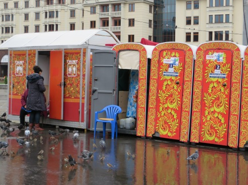Colors bleed out to the Porta Potties outside Red Square...