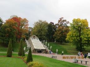 "A tiny fountain and foliage at the Peterhof Palace aka ""summer home."""
