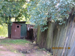 Wooden structure in the ghetto used as a bathroom.